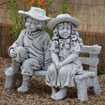 Boy & Girl on Bench Stone Sculpture - Large Garden Statue